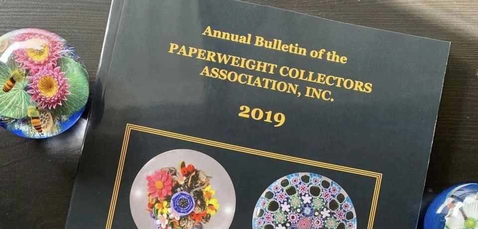Annual Bulletin Cover with Paperweights
